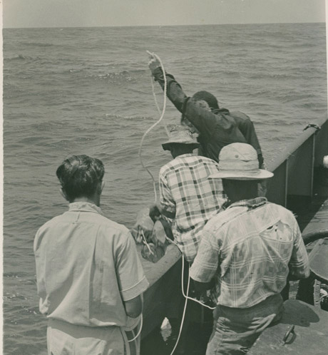 An image of Bill Travis and his diving staff on their lighter off Fort Jesus