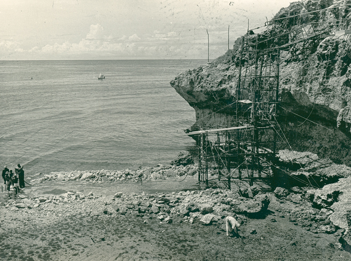 An image of an engineering work site at the base of cliffs on the shore of Mombasa Island