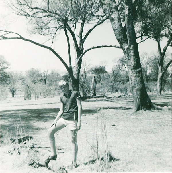 An image of Paul Augustinus standing in very arid bush country next to a waterhole