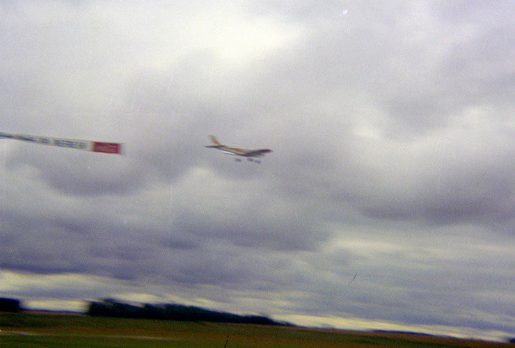 An image of  a RC model aircraft flying past with a trailing banner
