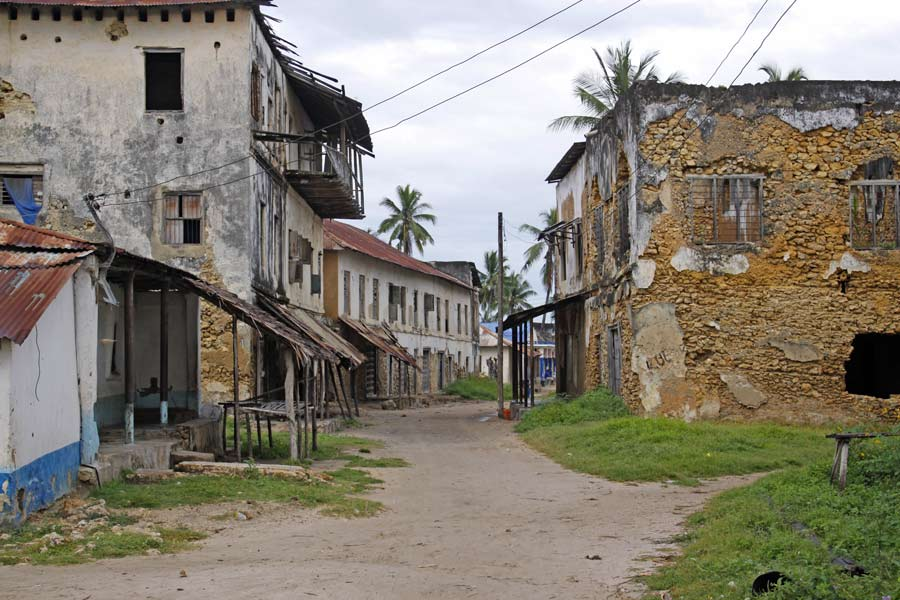 An image of a run down street with buildings that are charachteristic of the German Colonial period of Tanzania's history.