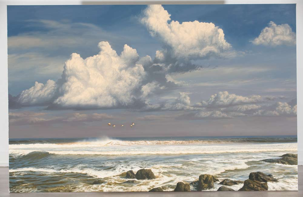 A Paul Augustinus painting of an Atlantic seascape with offshore winds and rolling breakers. Birds can be seen in the distance.