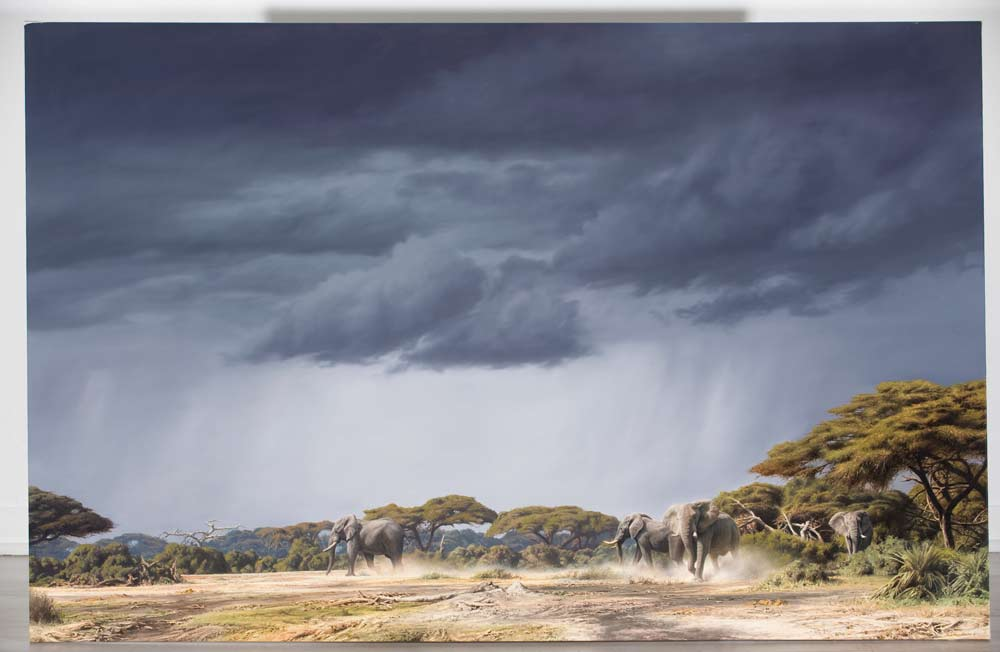 A Paul Augustinus painting of an alarmed elephant herd running across a clearing as a thunderstorm approaches.