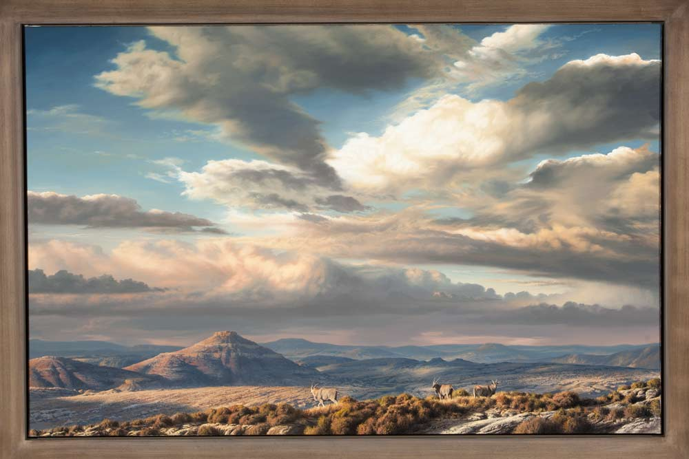 A Paul Augustinus painting of a cloud framed, mountain landscape in the harsh Karoo bush with eland in the foreground.