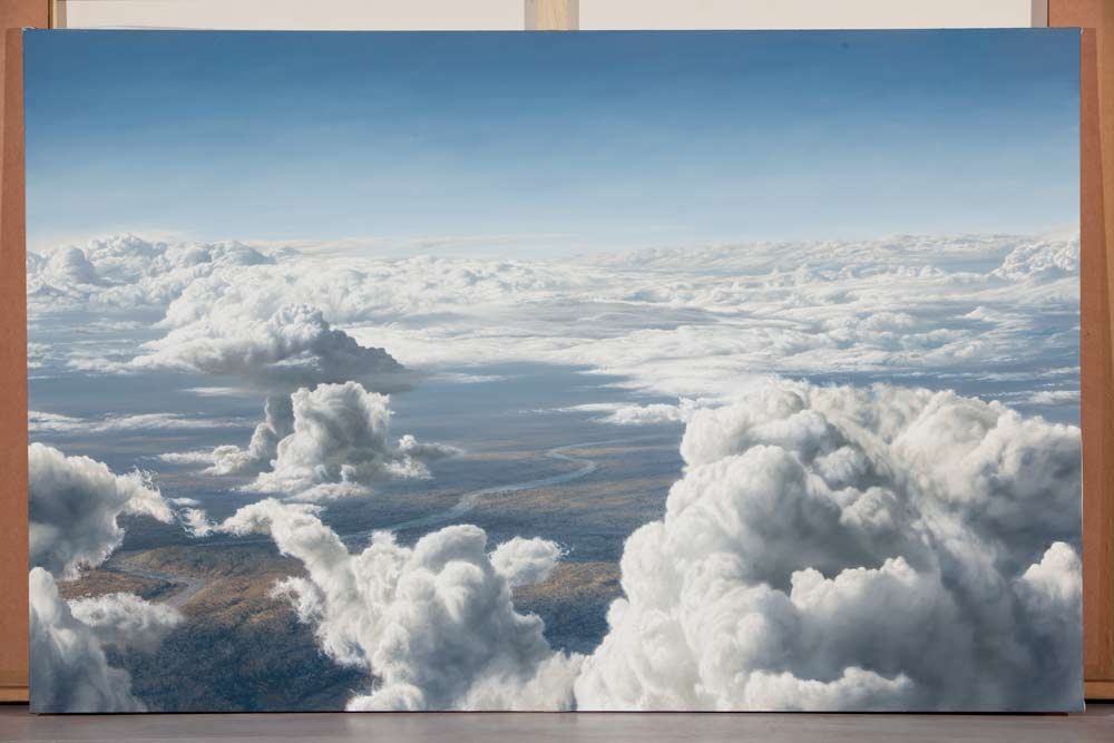 A Paul Augustinus painting of a flat plain with a river winding away into the distance , seen from high above the clouds, looking down.